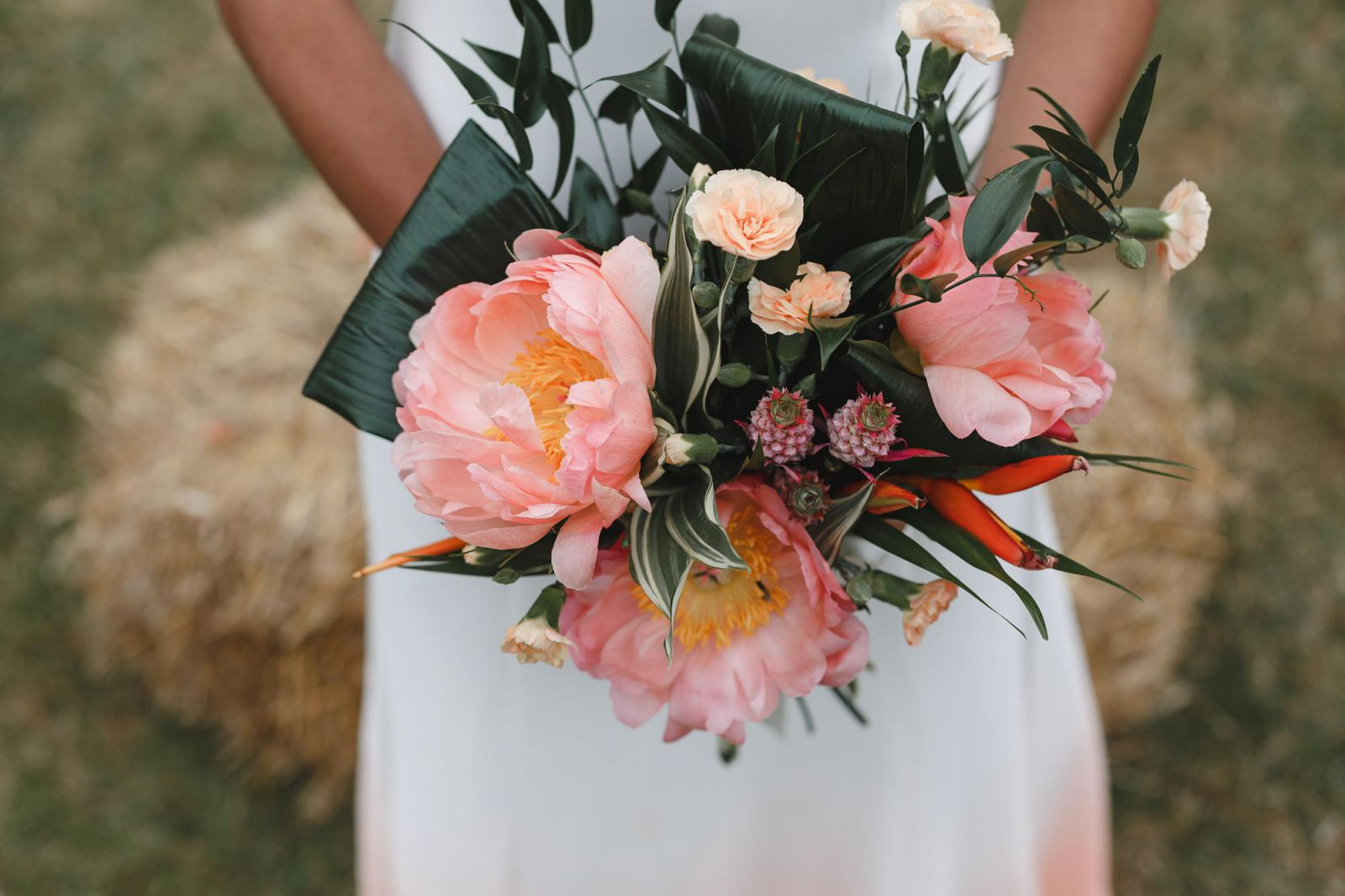 Hannah Green Photography A Young Bride Holds A Colourful Peach Bouquet At Stock Street Farm Barn Wedding Venue In Essex, UK